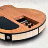 Headless hollow body electric guitar. Euro spruce, curly maple, african mahogany and ebony.